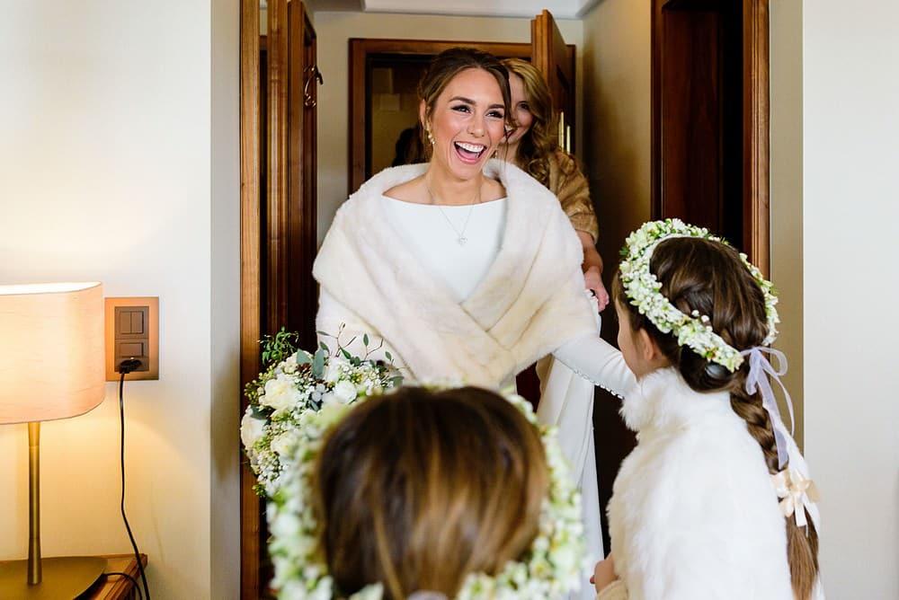 flower girls seeing the bride in her wedding dress in zermatt