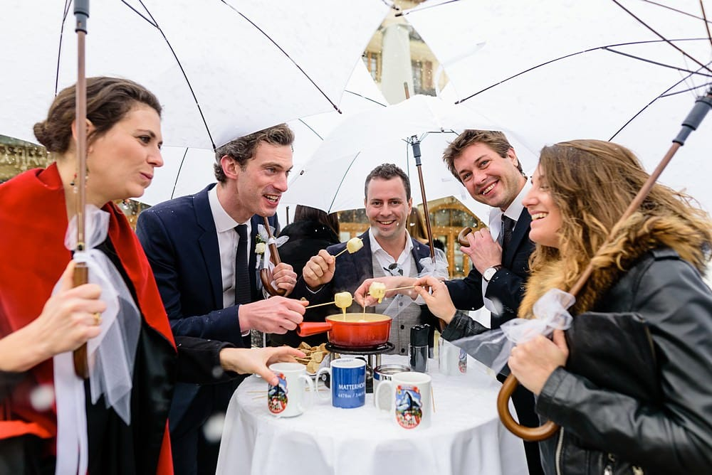Wedding guests enjoying fondue at the Grand Hotel Zermatterhof
