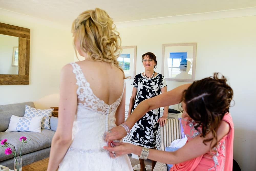 Bride getting into her dress on the Isles of Scillys