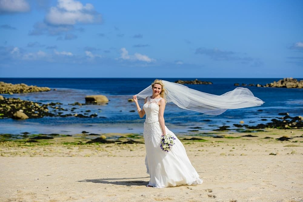 Bride posing for photos on the Isles of Scillies