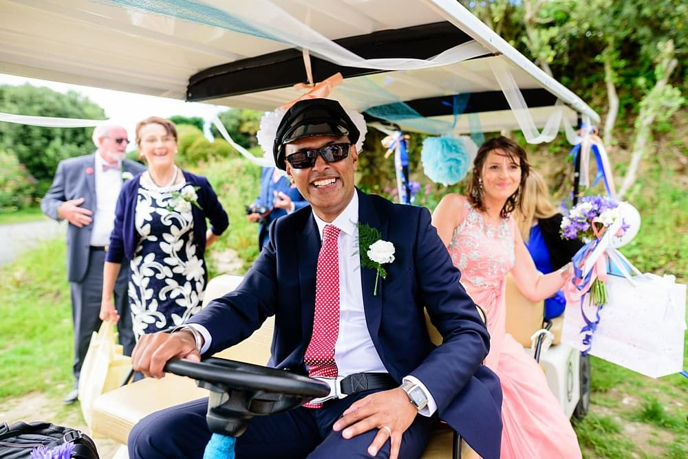 Wedding golf cart driver on the Isles of Scillies