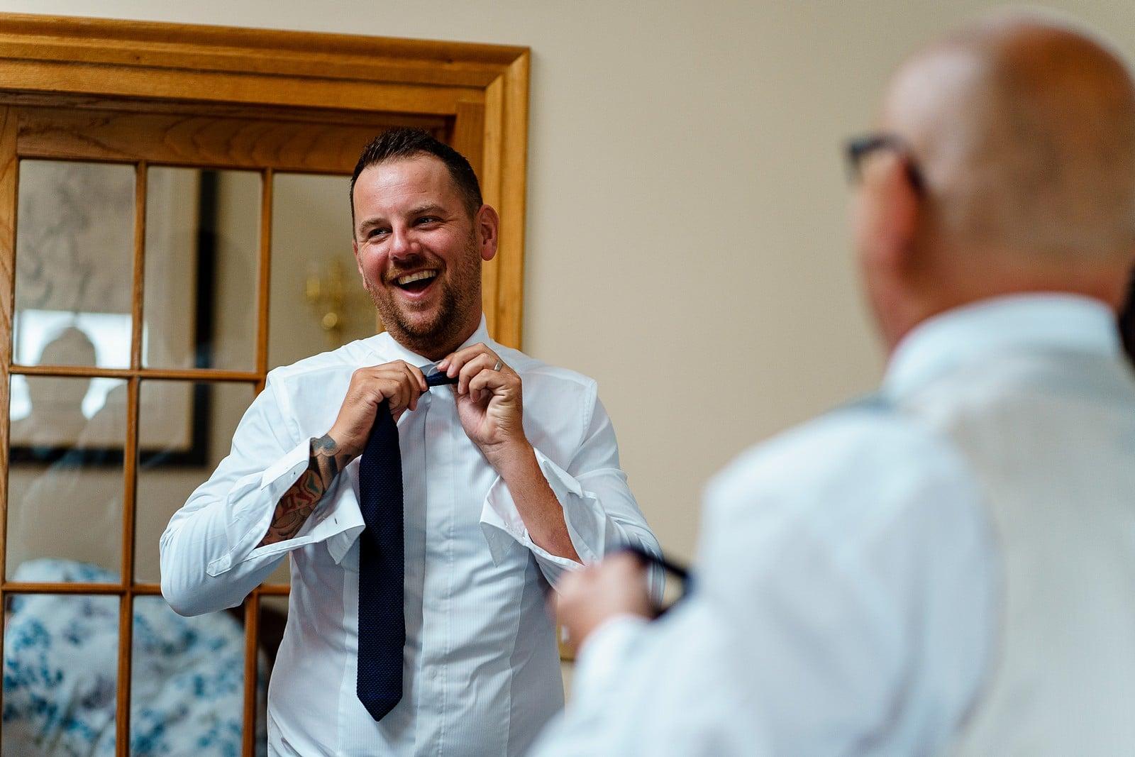 Fun groom prep for a falmouth wedding