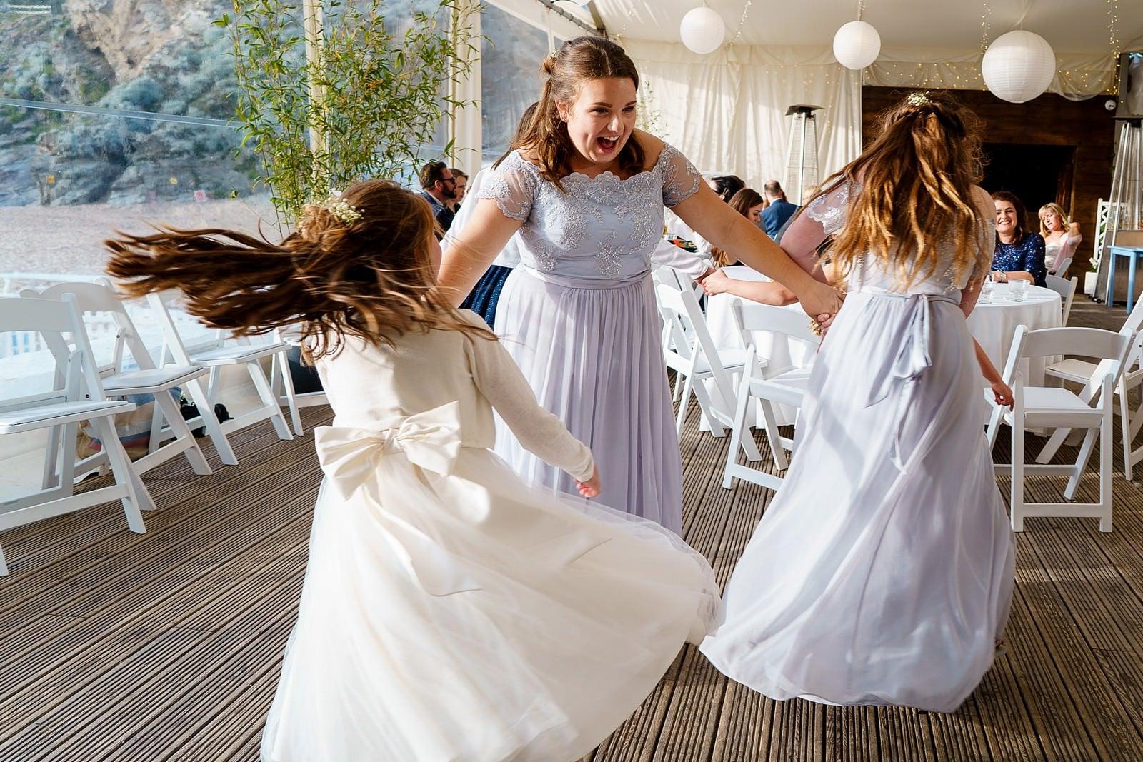 bridesmaids dancing at a lusty glaze wedding