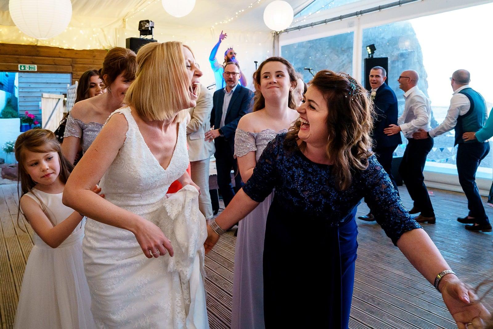 wedding party at lusty glaze beach