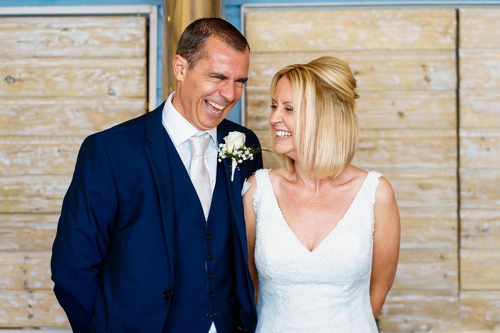 happy bride and groom getting married at lusty glaze in newquay
