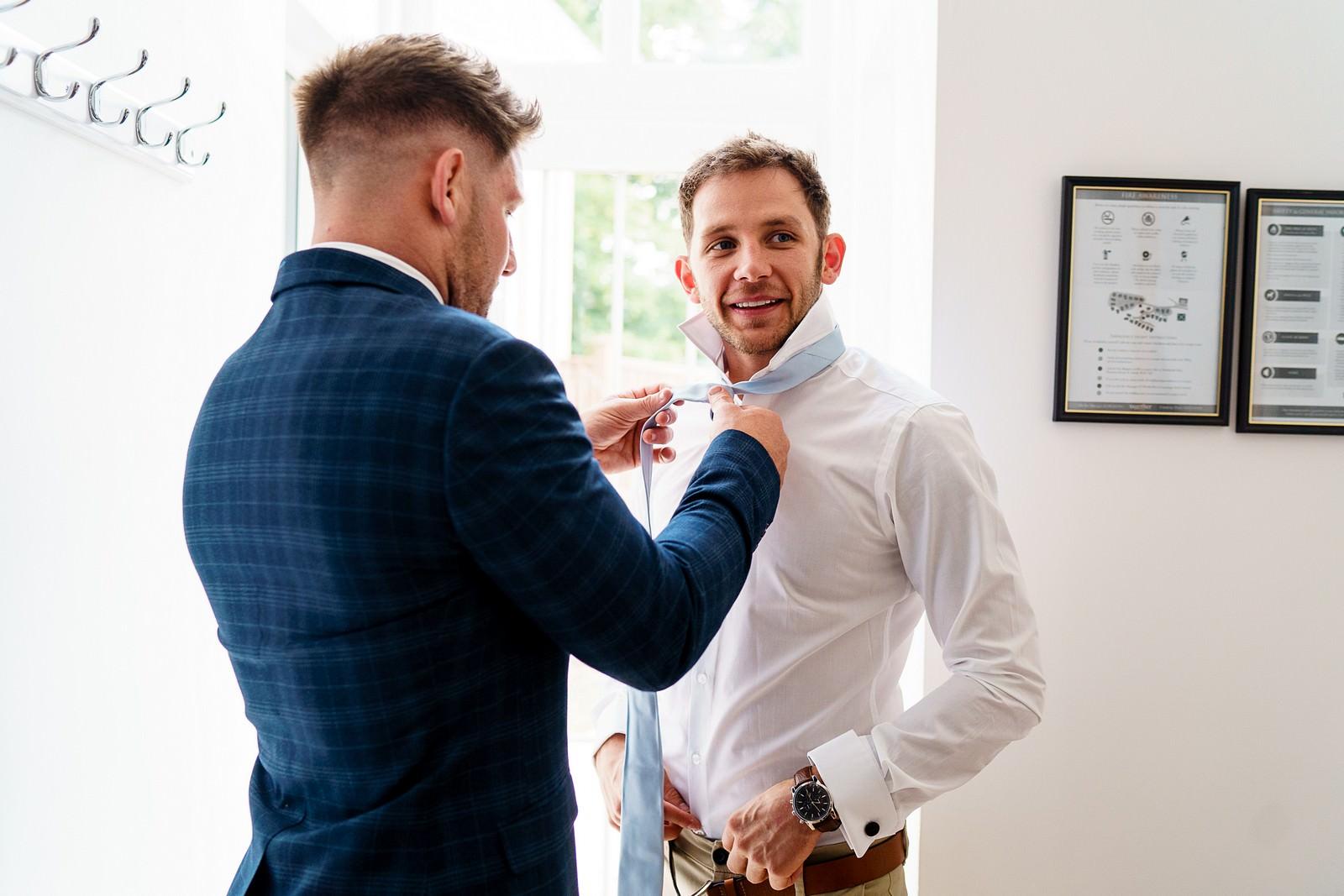 Best man getting ready for a knightor winery wedding 7