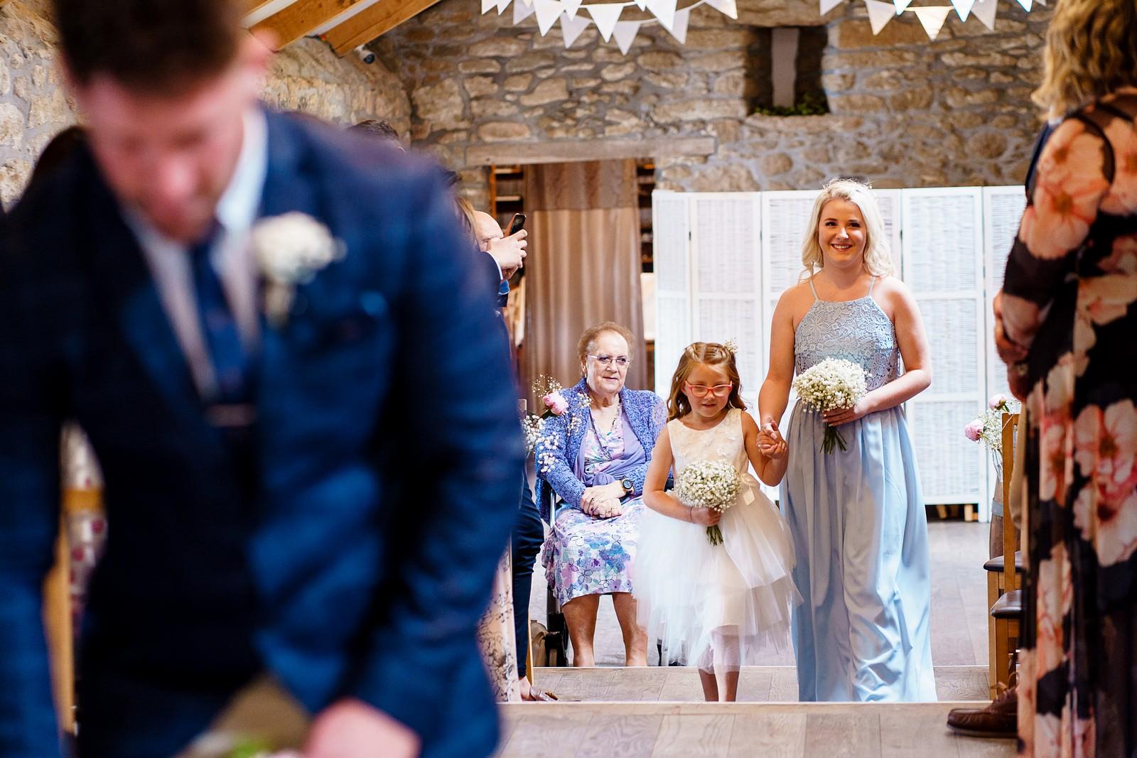 bridesmaids walking down the aisle at knightor winery 33