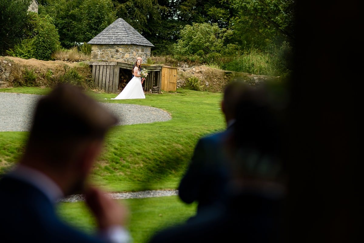 bride walking to her outside wedding ceremony at Trevenna barns