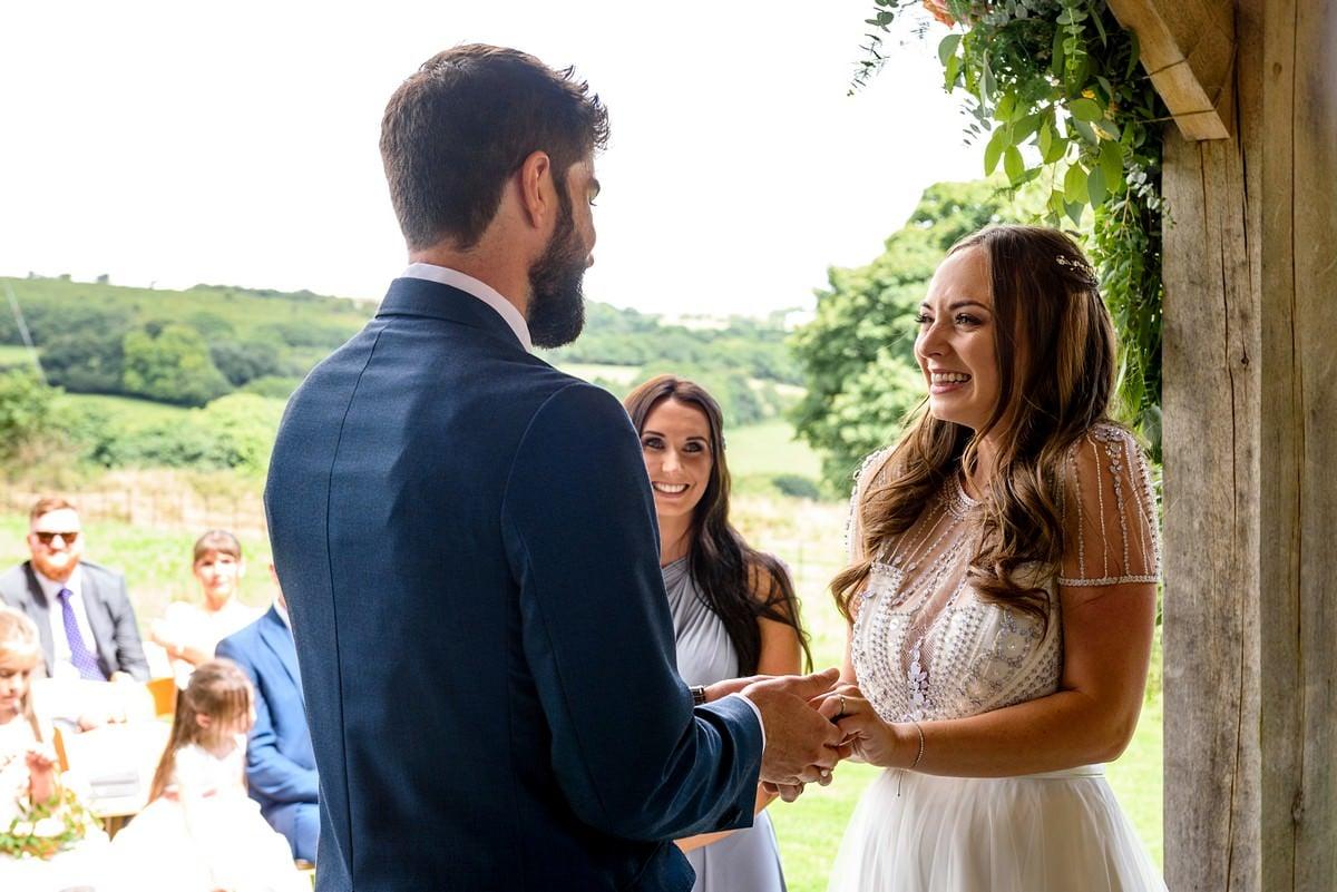 groom saying his vows at a trevenna barns wedding