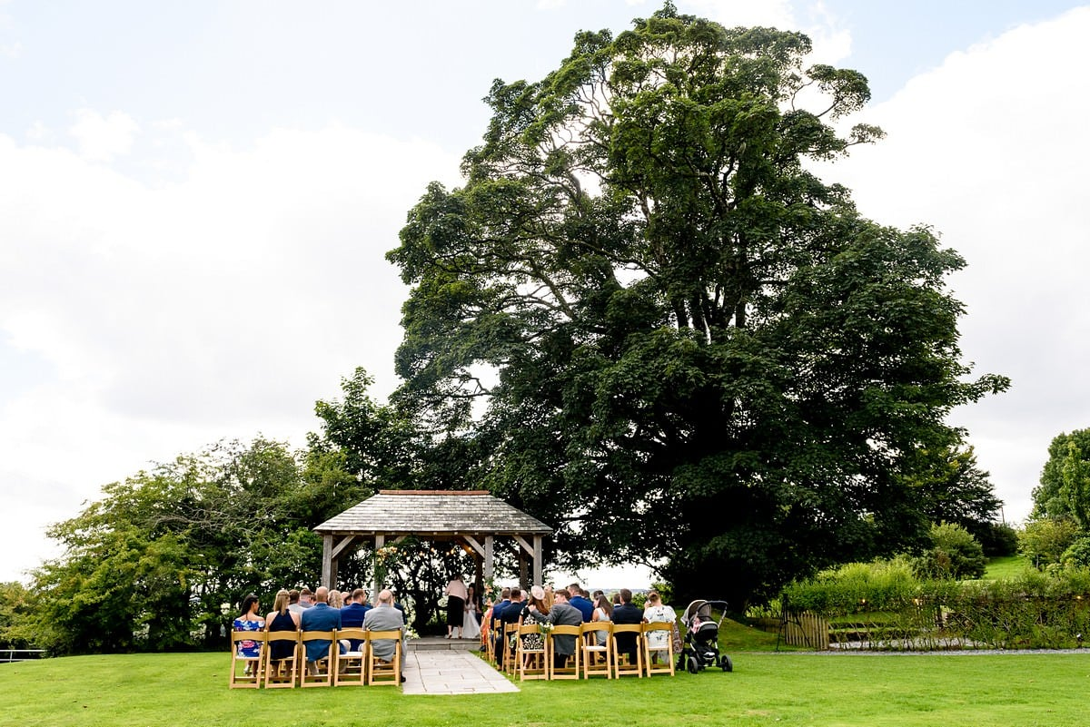 outside wedding ceremony at Trevenna barns