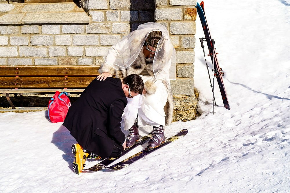 bride skiing at her Swiss alpes wedding