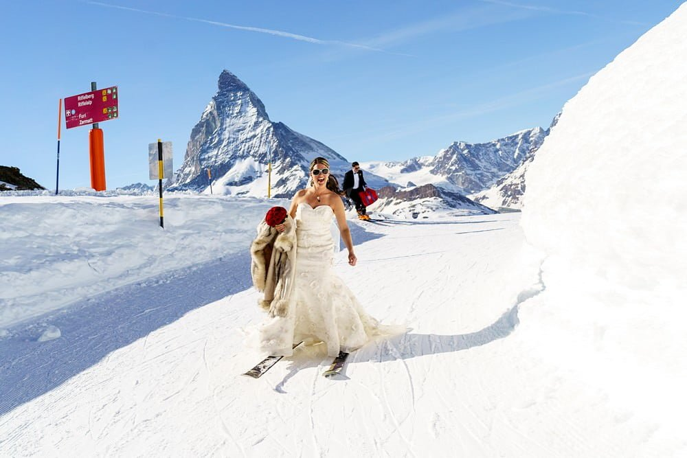 Bride skiing at her zermatt wedding