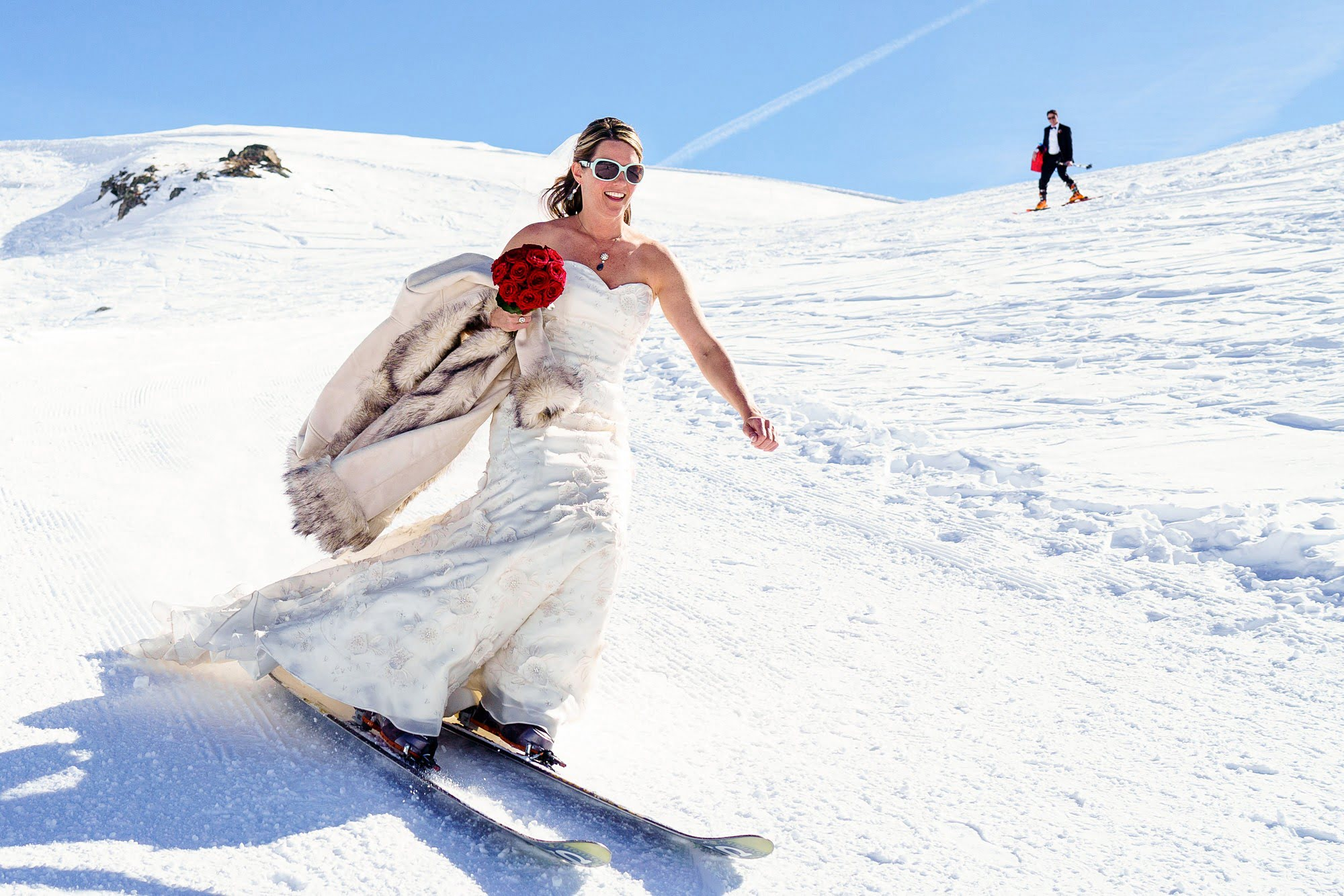 bride skiing to her wedding